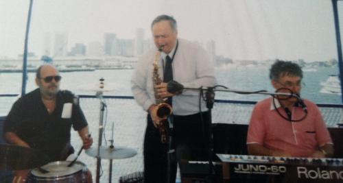 saxman Pete Stefan and keyboardist Michael Kaye on boat in Boston Harbor